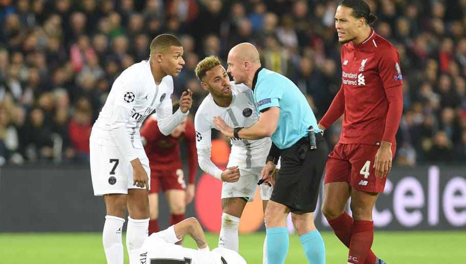 PARIS, FRANCE - NOVEMBER 28: Virgil Van Dijk of Liverpool reacts as Kylain Mbappe and Neymar of Paris Saint-Germain confront referee Szymon Marciniak as their teammate Angel Di Maria goes down injured during the Group C match of the UEFA Champions League between Paris Saint-Germain and Liverpool at Parc des Princes on November 28, 2018 in Paris, France. (Photo by Harriet Lander/Copa/Getty Images)