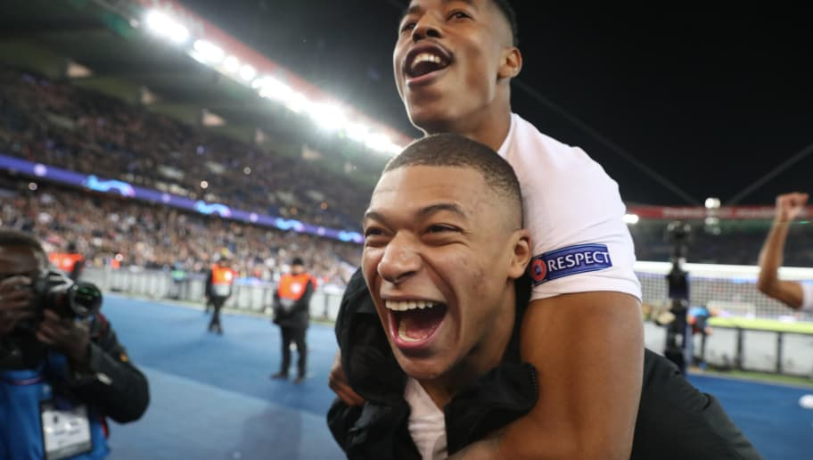 PARIS, FRANCE - NOVEMBER 28:  Kyllian Mbappe of Paris Saint-Germain celebrate the victory with Presnel Kimpembe after the Group C match of the UEFA Champions League between Paris Saint-Germain (PSG) and Liverpool FC at Parc des Princes on November 28, 2018 in Paris, France.  (Photo by Xavier Laine/Getty Images)