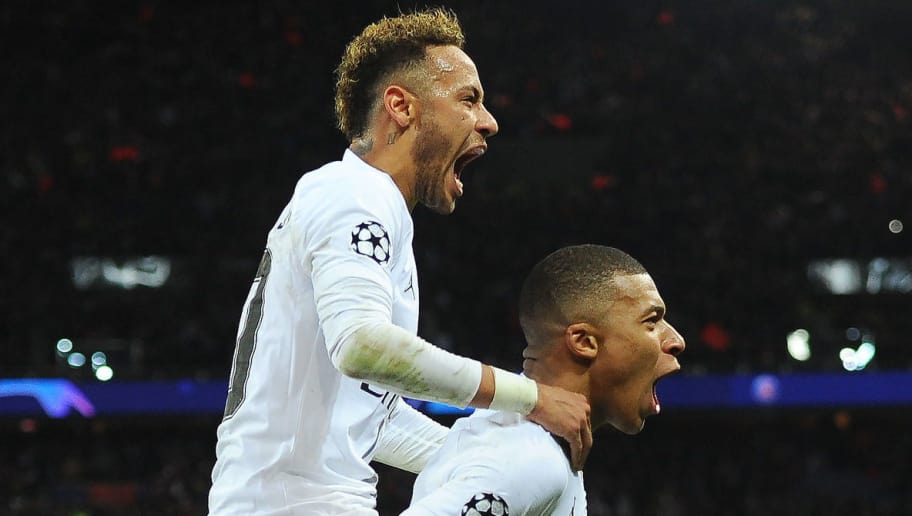 PARIS, FRANCE - NOVEMBER 28: Neymar of Paris Saint-Germain celebrates with teammate Kylian Mbappe after scoring his team's second goal during the Group C match of the UEFA Champions League between Paris Saint-Germain and Liverpool at Parc des Princes on November 28, 2018 in Paris, France. (Photo by Harriet Lander/Copa/Getty Images)