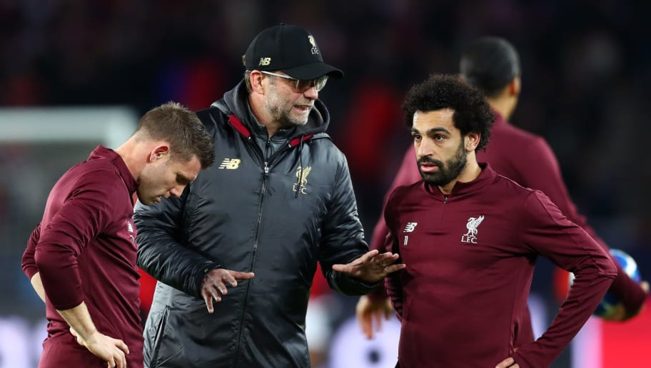 PARIS, FRANCE - NOVEMBER 28:  Jurgen Klopp, Manager of Liverpool speaks to James Milner of Liverpool and Mohamed Salah of Liverpool ahead of the UEFA Champions League Group C match between Paris Saint-Germain and Liverpool at Parc des Princes on November 28, 2018 in Paris, France.  (Photo by Clive Rose/Getty Images)