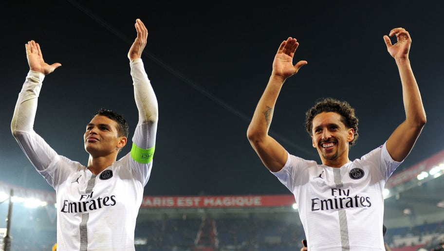 PARIS, FRANCE - NOVEMBER 28: Thiago Silva and Marquinhos of Paris Saint-Germain celebrate following their team's victory in the Group C match of the UEFA Champions League between Paris Saint-Germain and Liverpool at Parc des Princes on November 28, 2018 in Paris, France. (Photo by Harriet Lander/Copa/Getty Images)