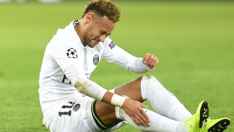 PARIS, FRANCE - NOVEMBER 28:  Neymar of Paris Saint-Germain goes down injured during the Group C match of the UEFA Champions League between Paris Saint-Germain and Liverpool at Parc des Princes on November 28, 2018 in Paris, France. (Photo by Harriet Lander/Copa/Getty Images)