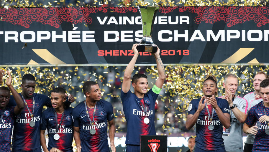 SHENZHEN, CHINA - AUGUST 04:  Players of Paris Saint-Germain celebrate with trophy after winning the French Trophy of Champions football match between AS Monaco and Paris Saint-Germain at Shenzhen Longgang Sports Center on August 4, 2018 in Shenzhen, China.  (Photo by Zhong Zhi/Getty Images)