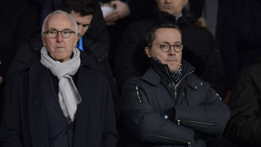 PARIS, FRANCE - FEBRUARY 25:  President of Olympique de Marseille Jacques-Henri Eyraud (L) and Olympique de Marseille Owner Frank McCourt attend the Ligue 1 match between Paris Saint Germain and Olympique Marseille February 25, 2018 in Paris, France.  (Photo by Aurelien Meunier/Getty Images)