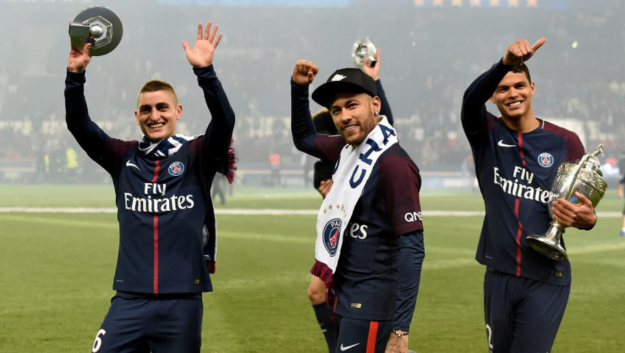 PARIS, FRANCE - MAY 12: (L-R) Marco Verratti of Paris Saint Germain, Neymar Jr of Paris Saint Germain, Thiago Silva of Paris Saint Germain celebrates the championship with the trophy  during the French League 1  match between Paris Saint Germain v Rennes at the Parc des Princes on May 12, 2018 in Paris France (Photo by Jean Marie Hervio/Soccrates/Getty Images)