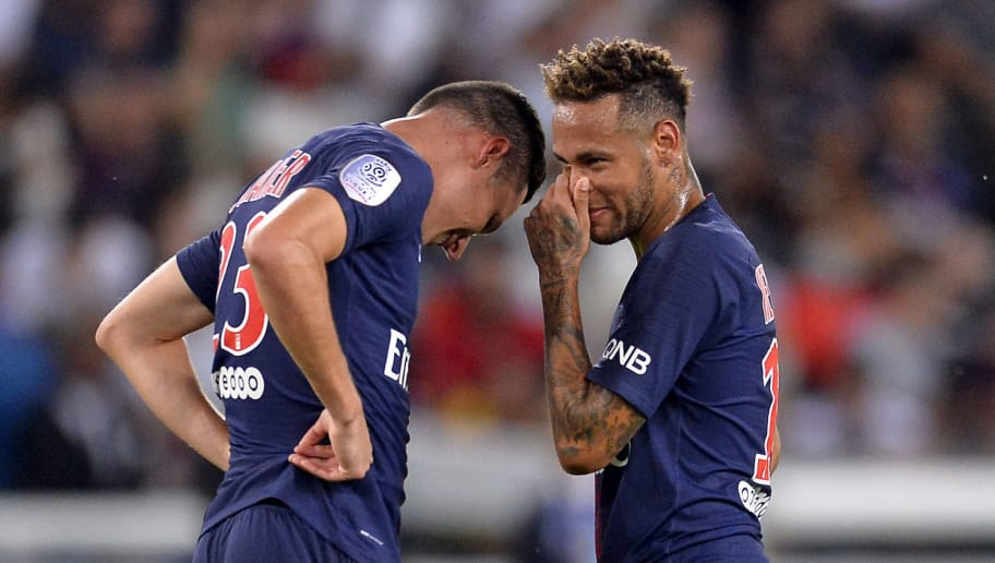 PARIS, FRANCE - AUGUST 12:  Neymar Jr and Julian Draxler of Paris Saint-Germain react before a free kick during the Ligue 1 match between Paris Saint-Germain and SM Caen at Parc des Princes on August 12, 2018 in Paris, France.  (Photo by Aurelien Meunier/Getty Images)