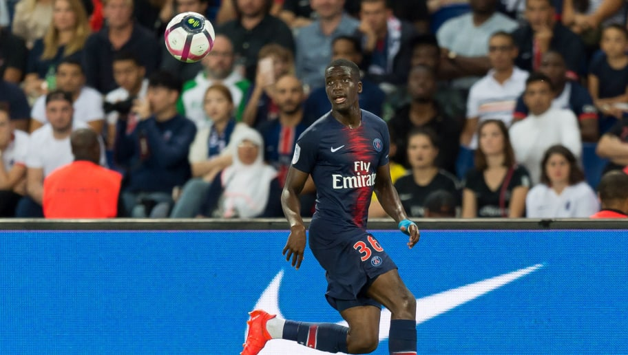 PARIS, FRANCE - AUGUST 12: Stanley N'Soki of Paris St. Germain controls the ball during the Ligue 1 match between Paris Saint-Germain and SM Caen at Parc des Princes on August 12, 2018 in Paris, France. (Photo by TF-Images/Getty Images)