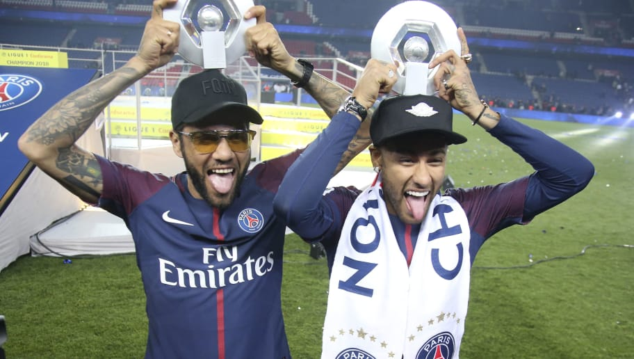 PARIS, FRANCE - MAY 12: Dani Alves aka Daniel Alves, Neymar Jr of PSG celebrate during the French Ligue 1 Championship Trophy Ceremony following the Ligue 1 match between Paris Saint-Germain (PSG) and Stade Rennais (Rennes) at Parc des Princes stadium on May 12, 2018 in Paris, France. (Photo by Jean Catuffe/Getty Images)