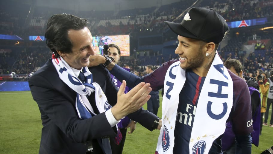 PARIS, FRANCE - MAY 12: Coach of PSG Unai Emery, Neymar Jr celebrate during the French Ligue 1 Championship Trophy Ceremony following the Ligue 1 match between Paris Saint-Germain (PSG) and Stade Rennais (Rennes) at Parc des Princes stadium on May 12, 2018 in Paris, France. (Photo by Jean Catuffe/Getty Images)