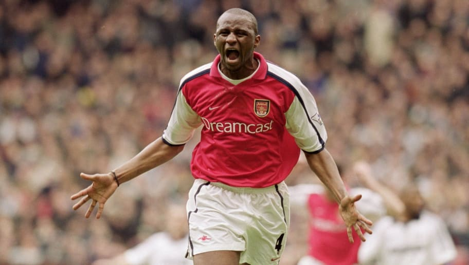 8 Apr 2001:  Patrick Vieira of Arsenal celebrates his goal during the AXA sponsored FA Cup Semi-Final match against Tottenham Hotspur played at Old Trafford, in Manchester, England. Arsenal won the match 2-1. \ Mandatory Credit: Ross Kinnaird /Allsport