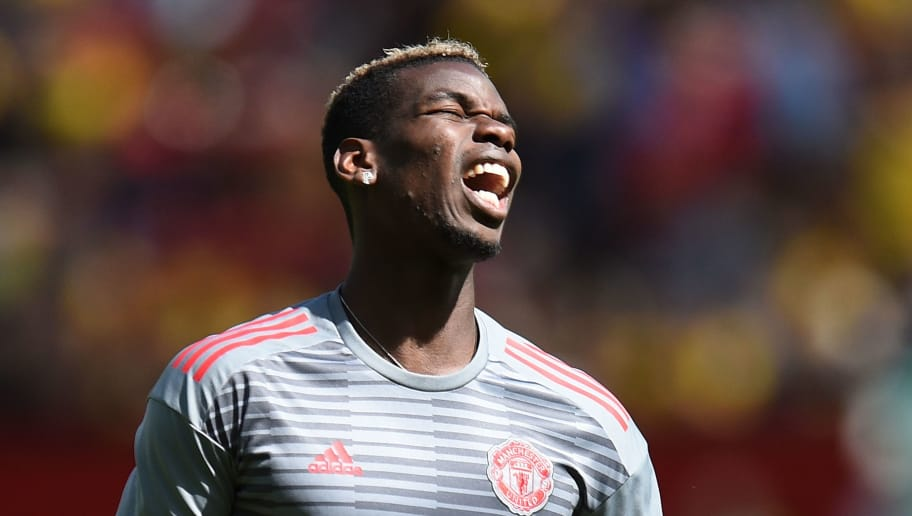 Manchester United's French midfielder Paul Pogba reacts as he warms up for the English Premier League football match between Manchester United and Watford at Old Trafford in Manchester, north west England, on May 13, 2018. (Photo by Oli SCARFF / AFP) / RESTRICTED TO EDITORIAL USE. No use with unauthorized audio, video, data, fixture lists, club/league logos or 'live' services. Online in-match use limited to 75 images, no video emulation. No use in betting, games or single club/league/player publications. /         (Photo credit should read OLI SCARFF/AFP/Getty Images)