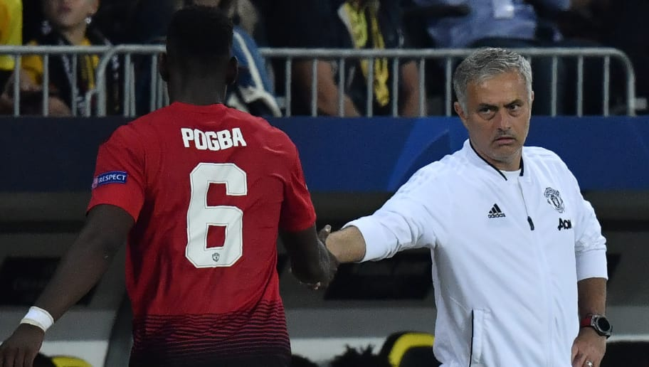 Manchester United's French midfielder Paul Pogba (L) shakes hands with Manchester United's Portuguese manager Jose Mourinho after his substitution during the UEFA Champions League group H football match between Young Boys and Manchester United at The Stade de Suisse in Bern on September 19, 2018. (Photo by Alain GROSCLAUDE / AFP)        (Photo credit should read ALAIN GROSCLAUDE/AFP/Getty Images)