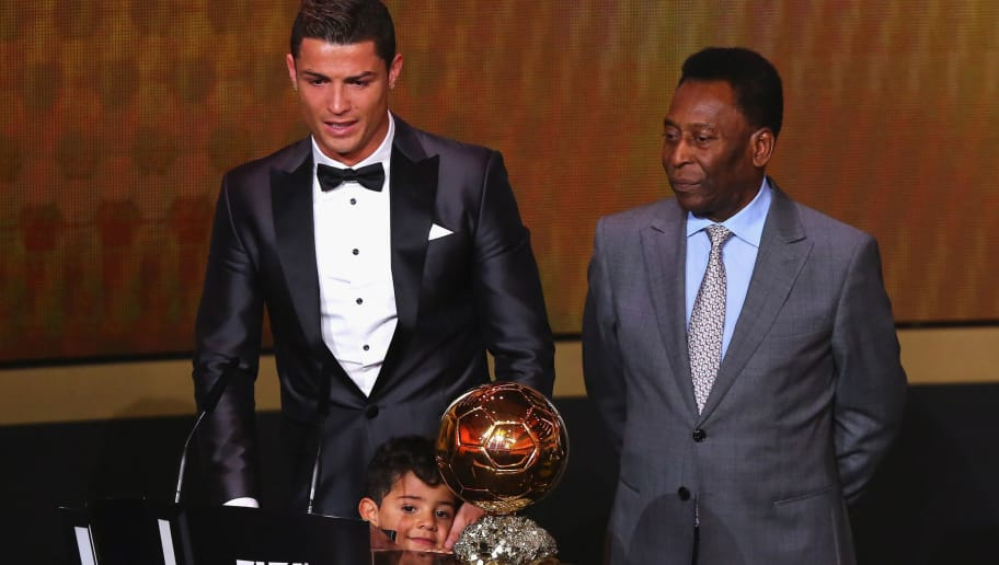 ZURICH, SWITZERLAND - JANUARY 13:  Crisitano Ronaldo (L) of Portugal withh his son Cristiano Ronaldo Jr receives the FIFA Ballon d'Or 2013 trophy at the Kongresshalle on January 13, 2014 in Zurich, Switzerland.  (Photo by Martin Rose/Bongarts/Getty Images)