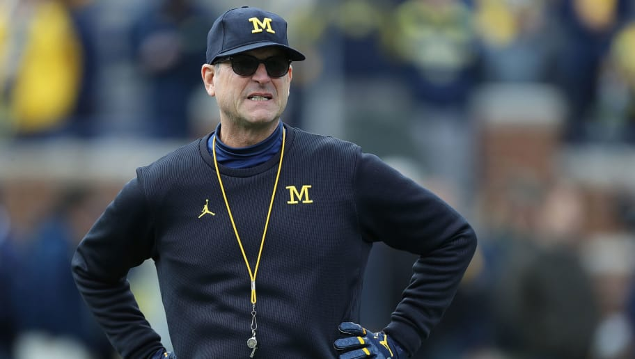 ANN ARBOR, MI - NOVEMBER 03: Michigan Wolverines head football Coach Jim Harbaugh watches the pregame warms up prior to the start of the game against the Penn State Nittany Lions at Michigan Stadium on November 3, 2018 in Ann Arbor, Michigan. Michigan defeated Penn State 42-7. (Photo by Leon Halip/Getty Images)