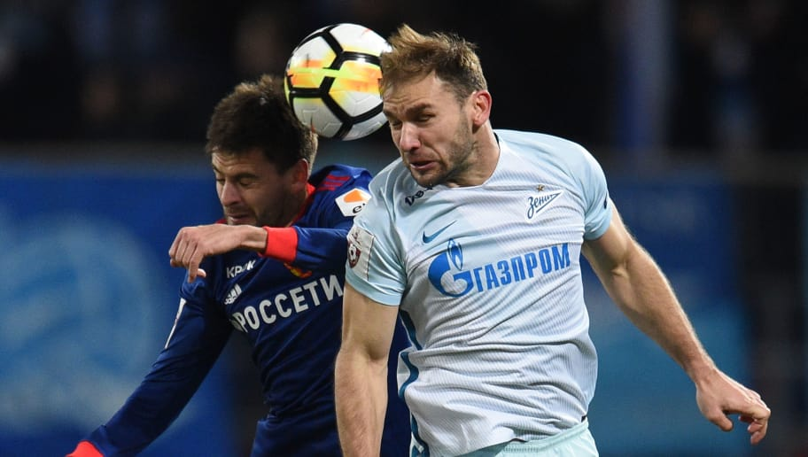 MOSCOW, RUSSIA - OCTOBER 22: Georgi Shchennikov (L) of PFC CSKA Moscow is challenged by Branislav Ivanovic of FC Zenit Saint Petersburg during the Russian Premier League match between PFC CSKA Moscow and FC Zenit Saint Petersburg at the VEB Arena Stadium on October 22, 2017 in Moscow, Russia. (Photo by Epsilon/Getty Images)