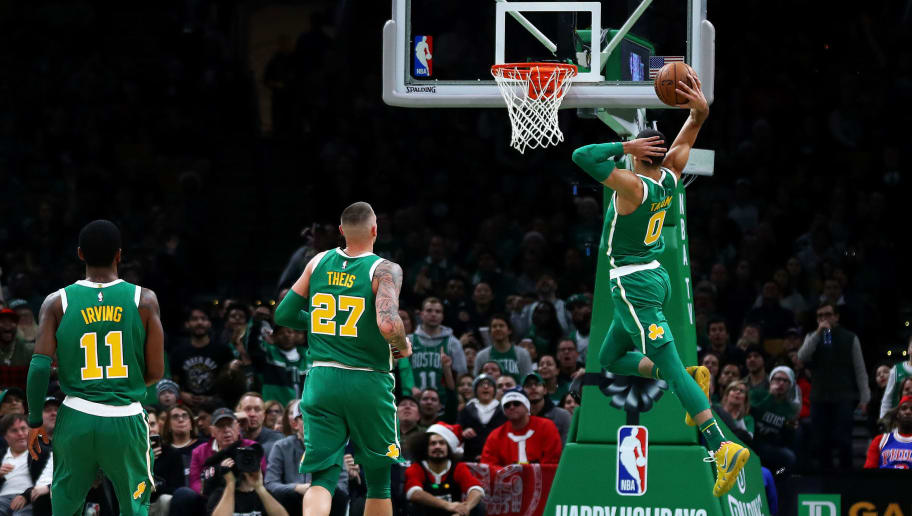 BOSTON, MASSACHUSETTS - DECEMBER 25: Jayson Tatum #0 of the Boston Celtics dunks during the second quarter of the game against the Philadelphia 76ers at TD Garden on December 25, 2018 in Boston, Massachusetts. NOTE TO USER: User expressly acknowledges and agrees that, by downloading and or using this photograph, User is consenting to the terms and conditions of the Getty Images License Agreement. (Photo by Omar Rawlings/Getty Images)