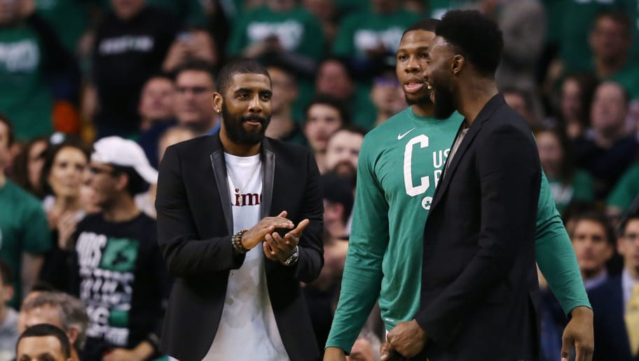 BOSTON, MA - APRIL 30: From left, Kyrie Irving #11 of the Boston Celtics, Guerschon Yabusele #30, and Jaylen Brown #7 cheer from the bench during the second quarter of Game One of Round Two of the 2018 NBA Playoffs against the Philadelphia 76ers at TD Garden on April 30, 2018 in Boston, Massachusetts. (Photo by Maddie Meyer/Getty Images)