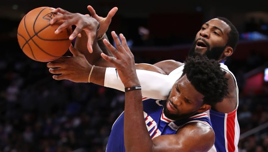 DETROIT, MI - OCTOBER 23:  Andre Drummond #0 of the Detroit Pistons battles for the ball with Joel Embiid #21 of the Philadelphia 76ers during the second half at Little Caesars Arena on October 23, 2018 in Detroit, Michigan. Detroit won the game 133-132 in overtime. NOTE TO USER: User expressly acknowledges and agrees that, by downloading and or using this photograph, User is consenting to the terms and conditions of the Getty Images License Agreement. (Photo by Gregory Shamus/Getty Images)