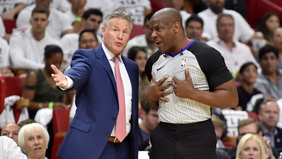 MIAMI, FL - APRIL 19: Head Coach Brett Brown of the Philadelphia 76ers talks to official Tony Brown during the game against the Miami Heat at American Airlines Arena on April 19, 2018 in Miami, Florida. NOTE TO USER: User expressly acknowledges and agrees that, by downloading and or using this photograph, User is consenting to the terms and conditions of the Getty Images License Agreement. (Photo by Eric Espada/Getty Images)