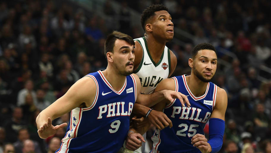 MILWAUKEE, WI - OCTOBER 24:  Giannis Antetokounmpo #34 of the Milwaukee Bucks is defended by Dario Saric #9 and Ben Simmons #25 of the Philadelphia 76ers during a game at the Fiserv Forum on October 24, 2018 in Milwaukee, Wisconsin. NOTE TO USER: User expressly acknowledges and agrees that, by downloading and or using this photograph, User is consenting to the terms and conditions of the Getty Images License Agreement.  (Photo by Stacy Revere/Getty Images)