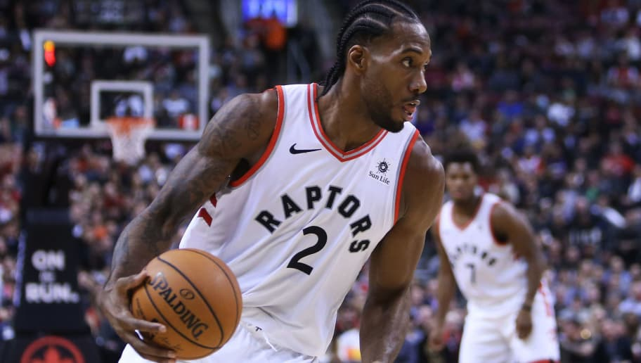 TORONTO, ON - OCTOBER 30:  Kawhi Leonard #2 of the Toronto Raptors dribbles the ball during the second half of an NBA game against the Philadelphia 76ers at Scotiabank Arena on October 30, 2018 in Toronto, Canada.  NOTE TO USER: User expressly acknowledges and agrees that, by downloading and or using this photograph, User is consenting to the terms and conditions of the Getty Images License Agreement.  (Photo by Vaughn Ridley/Getty Images)