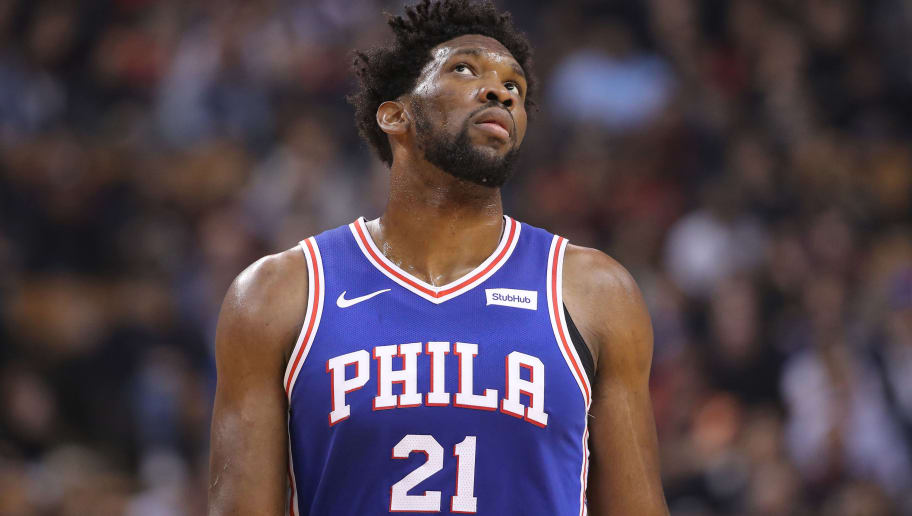 TORONTO, ON - DECEMBER 05: Joel Embiid #21 of the Philadelphia 76ers looks on during their NBA game against the Toronto Raptors at Scotiabank Arena on December 5, 2018 in Toronto, Canada. NOTE TO USER: User expressly acknowledges and agrees that, by downloading and or using this photograph, User is consenting to the terms and conditions of the Getty Images License Agreement. (Photo by Tom Szczerbowski/Getty Images)