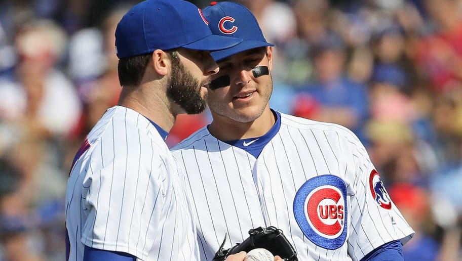 CHICAGO, IL - JUNE 07:   Anthony Rizzo #44 of the Chicago Cubs (R) congratulates Brandon Morrow #15 after Morrow caught a line drive in the 9th inning against the Philadelphia Phillies at Wrigley Field on June 7, 2018 in Chicago, Illinois. The Cubs defeated the Phillies 4-3. (Photo by Jonathan Daniel/Getty Images)