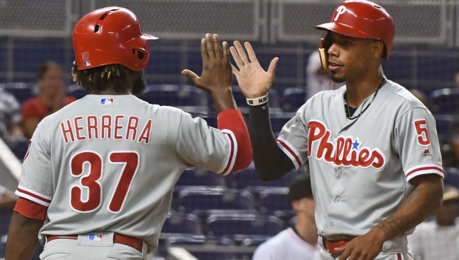 MIAMI, FL - SEPTEMBER 4: Nick Williams #5 of the Philadelphia Phillies is congratulated by Odubel Herrera #37 after scoring on a triple by Cesar Hernandez #16 during the first inning against the Miami Marlins at Marlins Park on September 4, 2018 in Miami, Florida.  (Photo by Eric Espada/Getty Images)