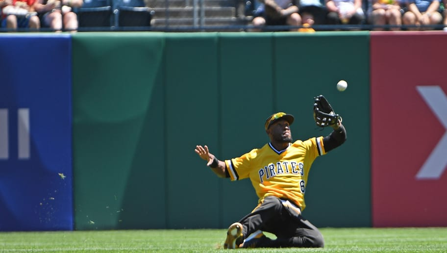 PITTSBURGH, PA - JULY 08: Starling Marte #6 of the Pittsburgh Pirates makes a sliding catch on a ball hit by Carlos Santana #41 of the Philadelphia Phillies in the fourth inning during the game at PNC Park on July 8, 2018 in Pittsburgh, Pennsylvania. (Photo by Justin Berl/Getty Images)