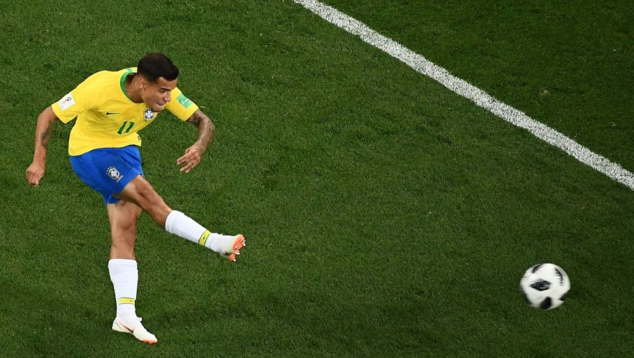 TOPSHOT - Brazil's forward Philippe Coutinho kicks and scores during the Russia 2018 World Cup Group E football match between Brazil and Switzerland at the Rostov Arena in Rostov-On-Don on June 17, 2018. (Photo by Jewel SAMAD / AFP) / RESTRICTED TO EDITORIAL USE - NO MOBILE PUSH ALERTS/DOWNLOADS        (Photo credit should read JEWEL SAMAD/AFP/Getty Images)