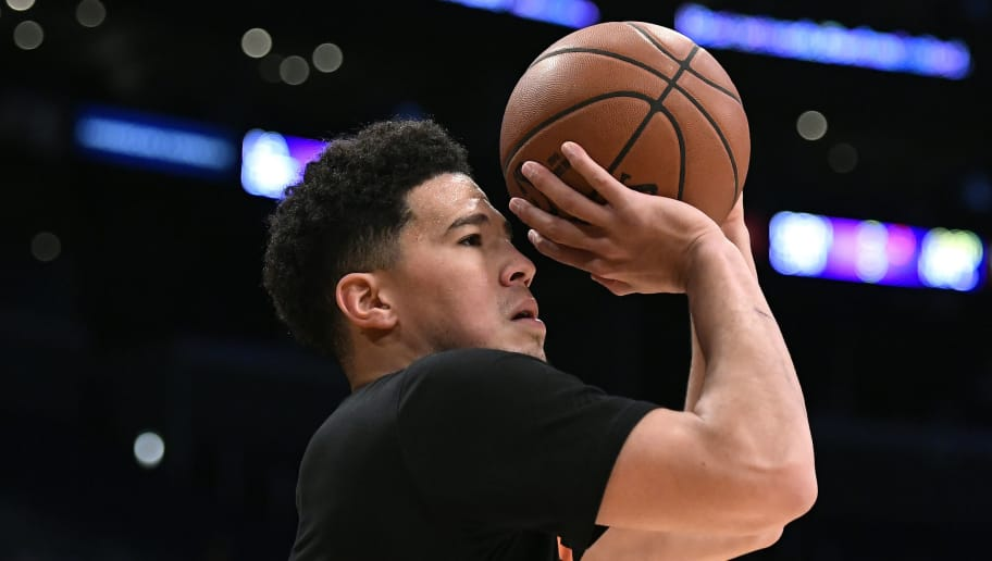 LOS ANGELES, CA - DECEMBER 02: Devin Booker #1 of the Phoenix Suns warms up before the start of a basketball game against Los Angeles Lakers at Staples Center on December 2, 2018 in Los Angeles, California. NOTE TO USER: User expressly acknowledges and agrees that, by downloading and or using this photograph, User is consenting to the terms and conditions of the Getty Images License Agreement. (Photo by Kevork Djansezian/Getty Images)