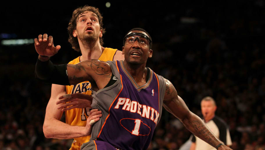 LOS ANGELES, CA - MAY 27:  Amar'e Stoudemire #1 of the Phoenix Suns fights for position with Pau Gasol #16 of the Los Angeles Lakers in the first quarter of Game Five of the Western Conference Finals during the 2010 NBA Playoffs at Staples Center on May 27, 2010 in Los Angeles, California. NOTE TO USER: User expressly acknowledges and agrees that, by downloading and/or using this Photograph, user is consenting to the terms and conditions of the Getty Images License Agreement.  (Photo by Jeff Gross/Getty Images)