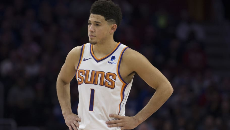 PHILADELPHIA, PA - NOVEMBER 19: Devin Booker #1 of the Phoenix Suns looks on against the Philadelphia 76ers at the Wells Fargo Center on November 19, 2018 in Philadelphia, Pennsylvania. NOTE TO USER: User expressly acknowledges and agrees that, by downloading and or using this photograph, User is consenting to the terms and conditions of the Getty Images License Agreement. (Photo by Mitchell Leff/Getty Images)