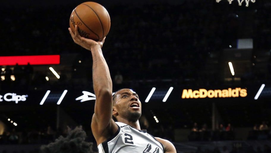 SAN ANTONIO,TX - JANUARY 05 :  Kawhi Leonard #2 of the San Antonio Spurs scores infant of Josh Jackson #20 of the Phoenix Suns at AT&T Center on January 05, 2018  in San Antonio, Texas.  NOTE TO USER: User expressly acknowledges and agrees that , by downloading and or using this photograph, User is consenting to the terms and conditions of the Getty Images License Agreement. (Photo by Ronald Cortes/Getty Images)