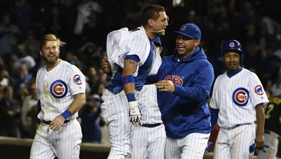 CHICAGO, IL - SEPTEMBER 26: Albert Almora Jr. #5 of the Chicago Cubs celebrates with his teammates after hitting a game-winning walk-off single against the Pittsburgh Pirates during the tenth inning on September 26, 2018 at Wrigley Field in Chicago, Illinois. The Cubs won 7-6. (Photo by David Banks/Getty Images)
