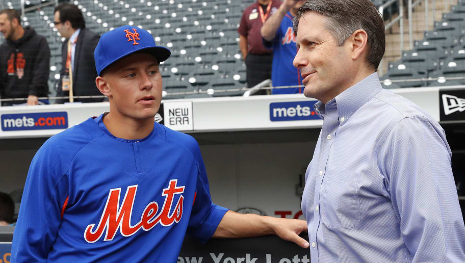 NEW YORK, NY - JUNE 27:  New York Mets first selection in the 2018 draft, Jarred Kelenic, talks with Mets assistant General Manager John Ricco during batting practice on the field before an MLB baseball game against the Pittsburgh Pirates on June 27, 2018 at Citi Field in the Queens borough of New York City. Pirates won 5-3. (Photo by Paul Bereswill/Getty Images)