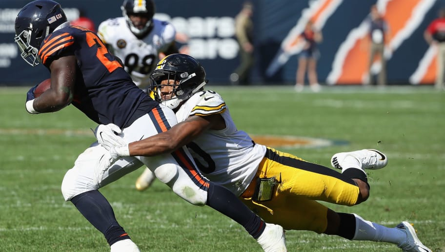 CHICAGO, IL - SEPTEMBER 24:  Jordan Howard #24 of the Chicago Bears is tackled by Ryan Shazier #50 of the Pittsburgh Steelers at Soldier Field on September 24, 2017 in Chicago, Illinois. The Bears defeated the Steelers 23-17 in overtime.  (Photo by Jonathan Daniel/Getty Images)