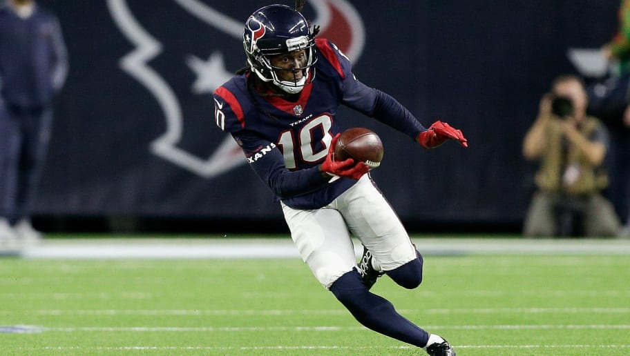 HOUSTON, TX - DECEMBER 25: DeAndre Hopkins #10 of the Houston Texans runs with the ball after a catch against the Pittsburgh Steelers during game action at NRG Stadium on December 25, 2017 in Houston, Texas. The Pittsburgh Steelers defeated the Houston Texans 34-6. (Photo by Bob Levey/Getty Images)