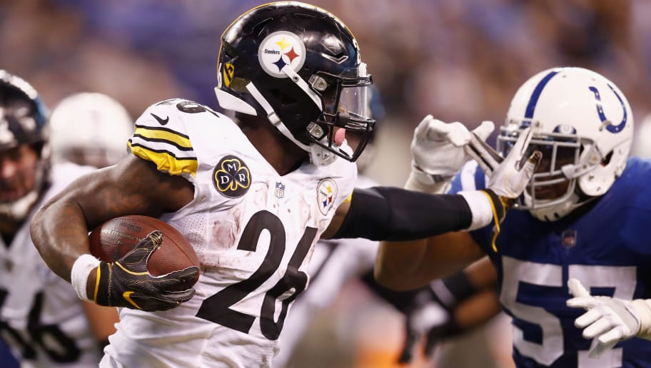 INDIANAPOLIS, IN - NOVEMBER 12:  Le'Veon Bell #26 of the Pittsburgh Steelers stiff arms Jon Bostic #57 of the Indianapolis Colts during the second half at Lucas Oil Stadium on November 12, 2017 in Indianapolis, Indiana.  (Photo by Andy Lyons/Getty Images)