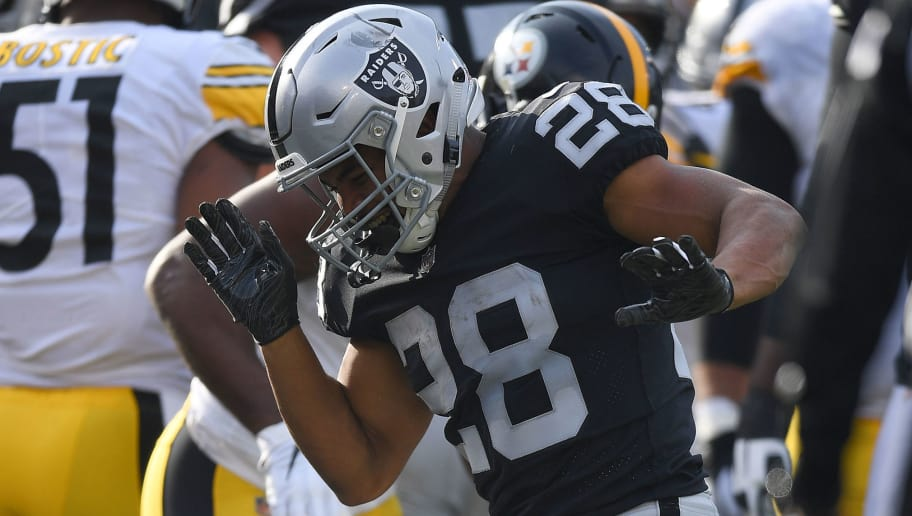 OAKLAND, CA - DECEMBER 09:  Doug Martin #28 of the Oakland Raiders celebrates after scoring on a one-yard touchdown run against the Pittsburgh Steelers during the first half of their NFL football game at Oakland-Alameda County Coliseum on December 9, 2018 in Oakland, California.  (Photo by Thearon W. Henderson/Getty Images)