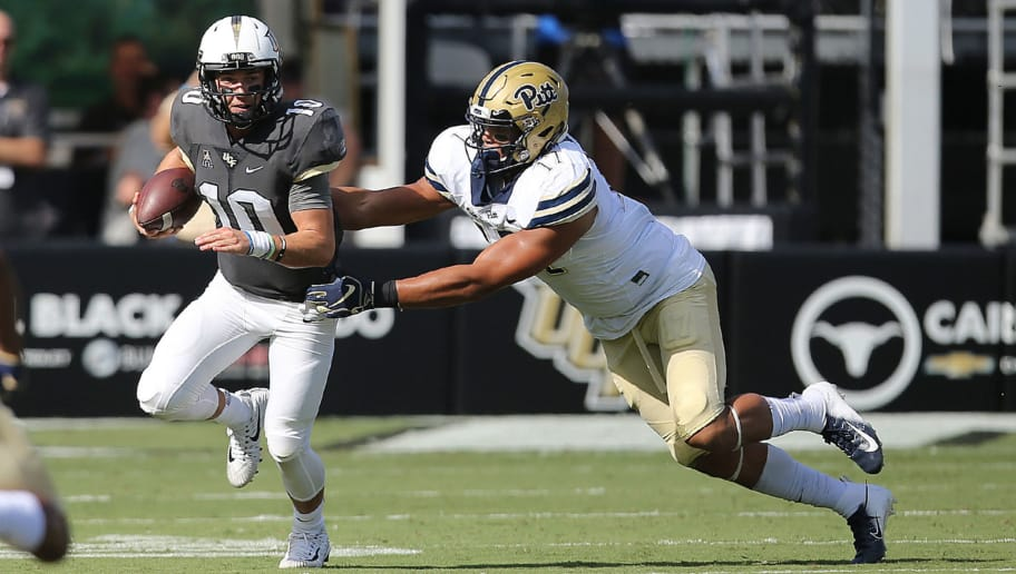 ORLANDO, FL - SEPTEMBER 29:   McKenzie Milton #10 of the UCF Knights outruns Rashad Weaver #17 of the Pittsburgh Panthers during a game at Spectrum Stadium on September 29, 2018 in Orlando, Florida. (Photo by Alex Menendez/Getty Images)