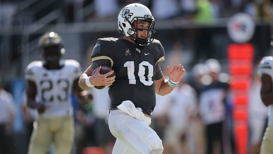 ORLANDO, FL - SEPTEMBER 29:   McKenzie Milton #10 of the UCF Knights runs into the end zone for a touchdown during a game between the Pittsburgh Panthers and the UCF Knights at Spectrum Stadium on September 29, 2018 in Orlando, Florida. (Photo by Alex Menendez/Getty Images)