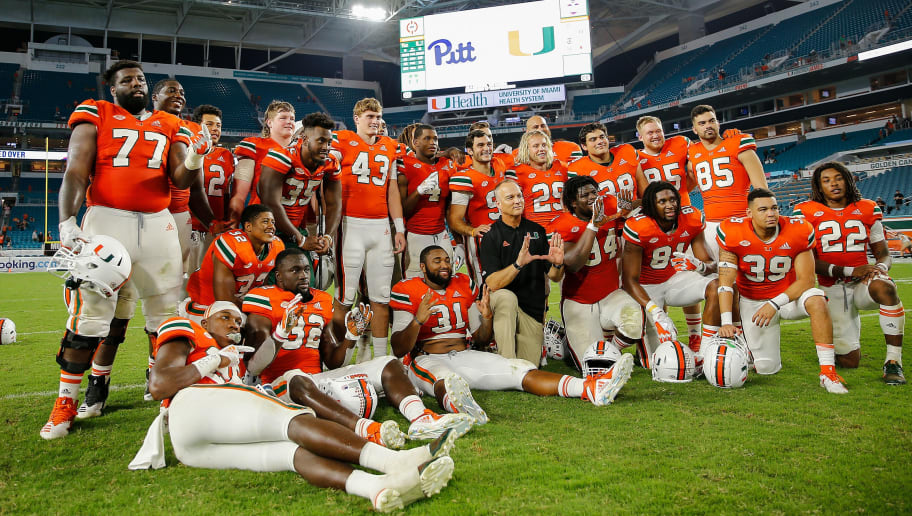 MIAMI GARDENS, FL - NOVEMBER 24:  The Miami Hurricanes seniors pose for a photo with head coach Mark Richt after the game against the Pittsburgh Panthers at Hard Rock Stadium on November 24, 2018 in Miami Gardens, Florida.  (Photo by Michael Reaves/Getty Images)