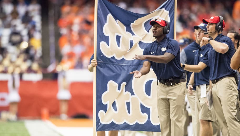 SYRACUSE, NY - OCTOBER 07:  Pittsburgh Panthers staff signals to players while being obscured by a Pitt banner during the first half against the Syracuse Orange at the Carrier Dome on October 7, 2017 in Syracuse, New York. Syracuse defeats Pittsburgh 27-24.  (Photo by Brett Carlsen/Getty Images) *** Local Caption ***
