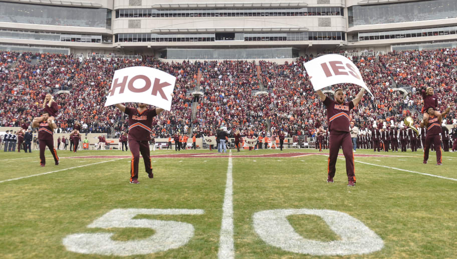BLACKSBURG, VA - NOVEMBER 18: Members of the Virginia Tech Hokies cheerleading squad perform prior to the game against the Pittsburgh Panthers at Lane Stadium on November 18, 2017 in Blacksburg, Virginia. (Photo by Michael Shroyer/Getty Images) *** Local Caption ***