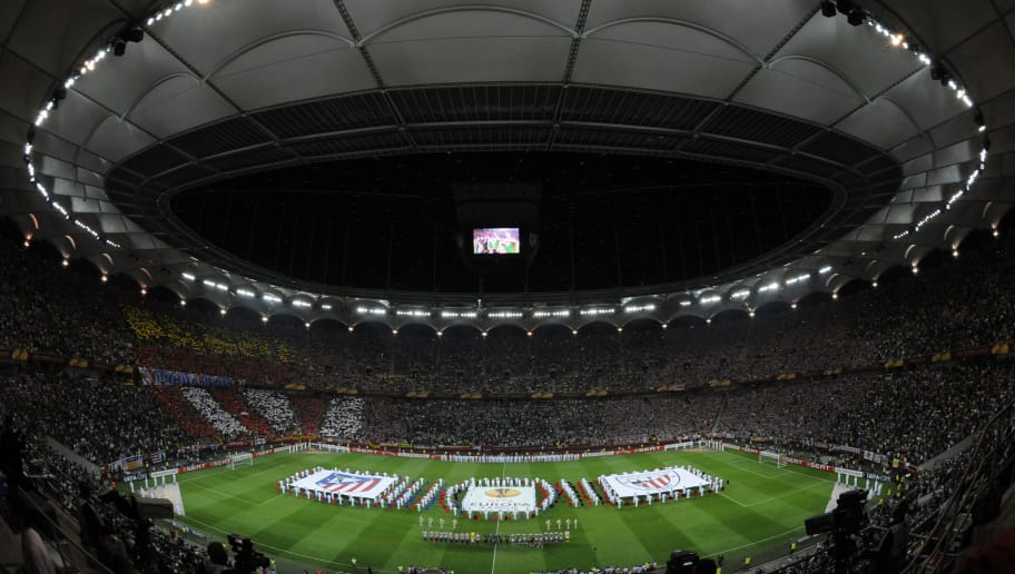 Players and referee stand on the pitch at the end of the opening ceremony of the 2012 UEFA Europa League final football match between Club Atletico Madrid and Athletic Club Bilbao on May 9, 2012 at the National Arena stadium in Bucharest.    AFP PHOTO / BARBARA SAX        (Photo credit should read BARBARA SAX/AFP/GettyImages)