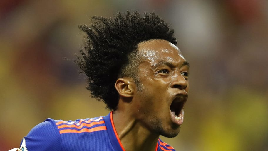 KAZAN, RUSSIA - JUNE 24:  Juan Cuadrado of Colombia  celebrates after scoring his team's third goal during the 2018 FIFA World Cup Russia group H match between Poland and Colombia at Kazan Arena on June 24, 2018 in Kazan, Russia.  (Photo by Julian Finney/Getty Images)