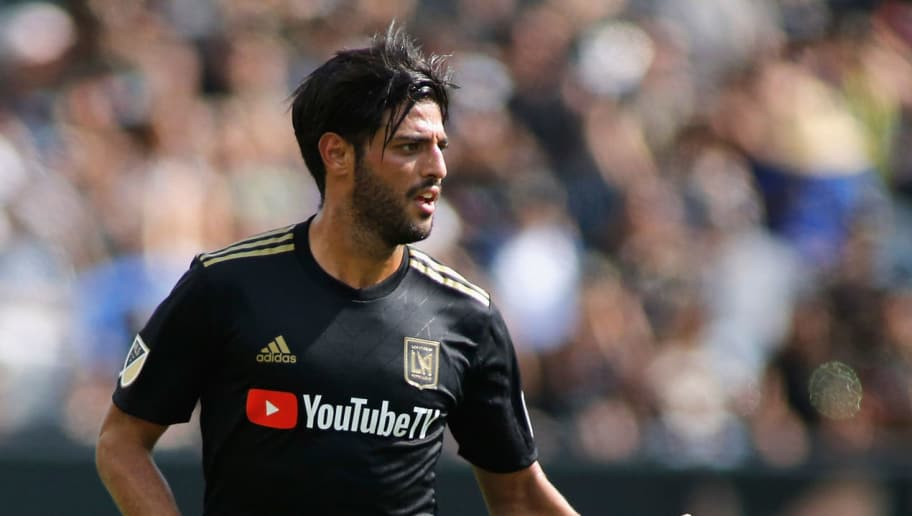 LOS ANGELES, CA - JULY 15:  Carlos Vela #10 of the Los Angeles Football Club dribbles down the field during action against the Portland Timbers at Banc of California Stadium on July 15, 2018 in Los Angeles, California.  (Photo by Katharine Lotze/Getty Images)