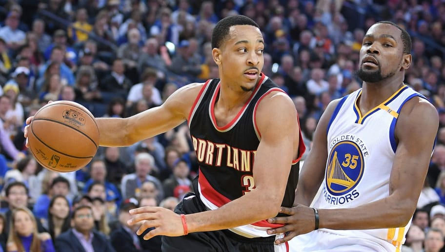 OAKLAND, CA - JANUARY 04:  C.J. McCollum #3 of the Portland Trail Blazers drives to the basket past Kevin Durant #35 of the Golden State Warriors during an NBA basketball game at ORACLE Arena on January 2, 2017 in Oakland, California. NOTE TO USER: User expressly acknowledges and agrees that, by downloading and or using this photograph, User is consenting to the terms and conditions of the Getty Images License Agreement.  (Photo by Thearon W. Henderson/Getty Images)
