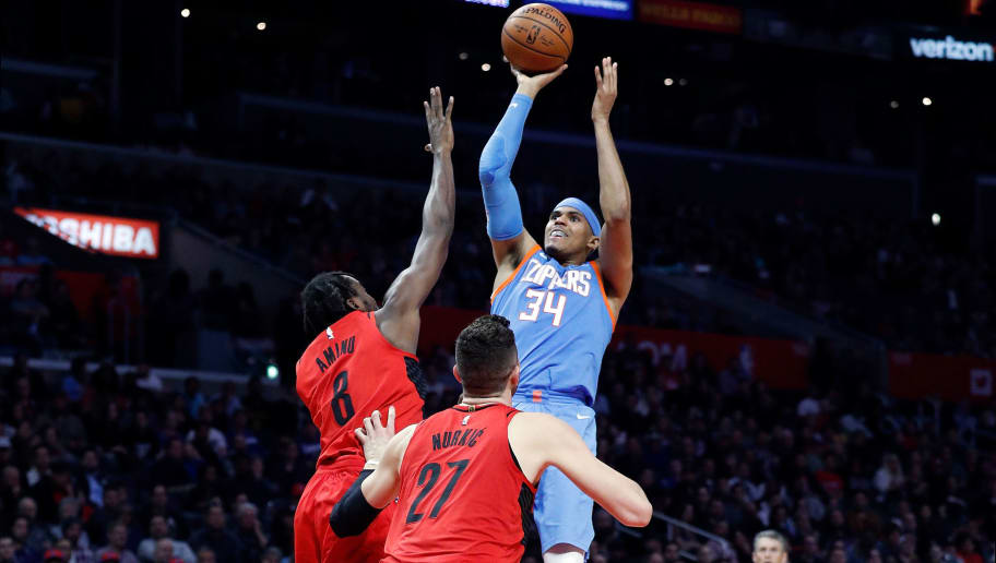 LOS ANGELES, CA - MARCH 18:  Tobias Harris #34 of the LA Clippers shoots over Al-Farouq Aminu #8 of the Portland Trail Blazers during the second half of the game at the Staples Center on March 18, 2018 in Los Angeles, California.  NOTE TO USER: User expressly acknowledges and agrees that, by downloading and or using this photograph, User is consenting to the terms and conditions of the Getty Images License Agreement.  (Photo by Josh Lefkowitz/Getty Images)